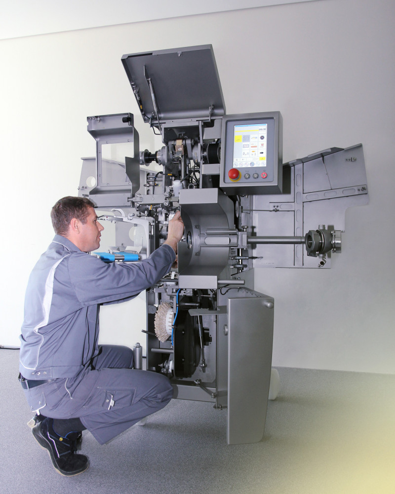 service employee working in clipping machine