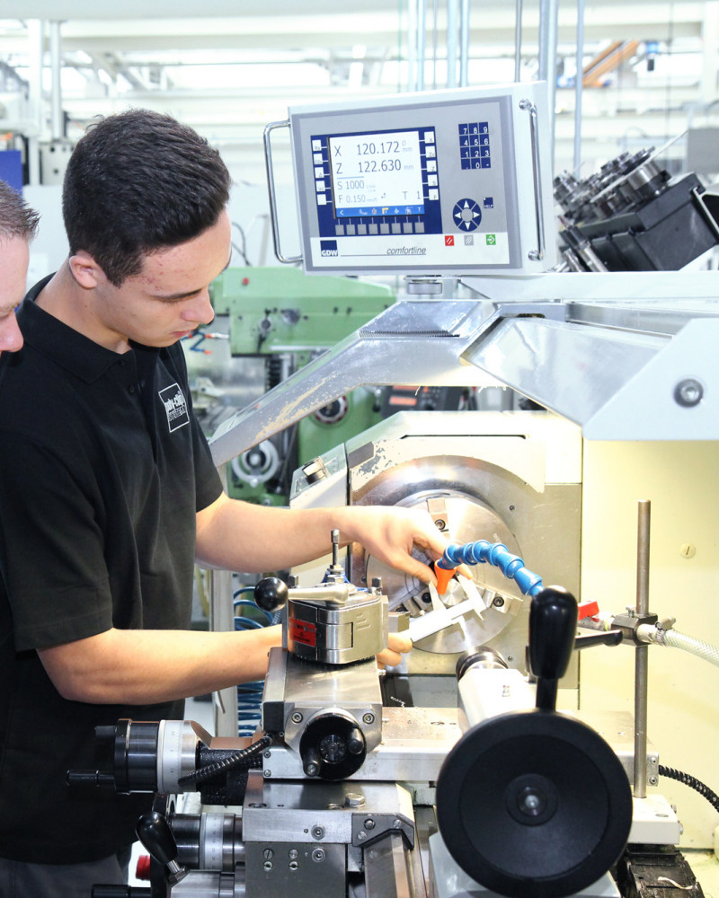 two employees working on clippiing machine