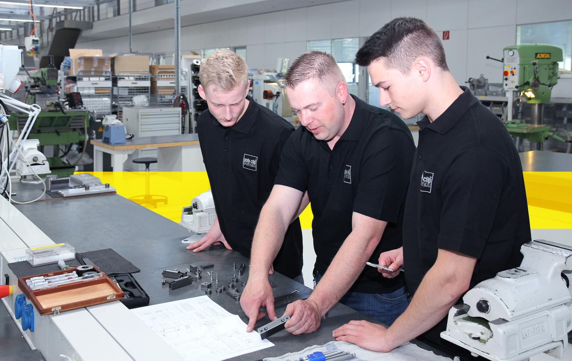 three employees working