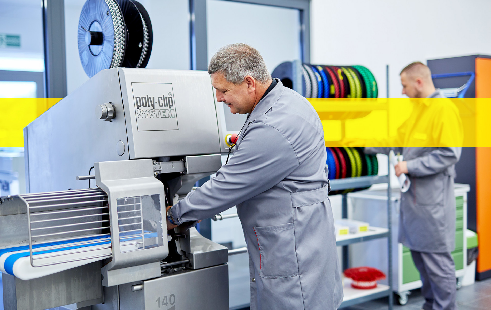 service employee working in front of machine consumables